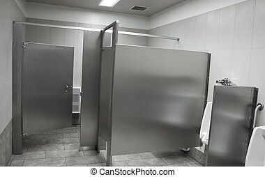 Public washroom stall with black and white toned