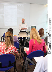 Teacher stood at front of class room