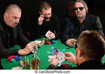 Group of poker players - Photo of three male poker players...