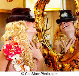 fashion blond woman with hat in baroque golden mirror -...