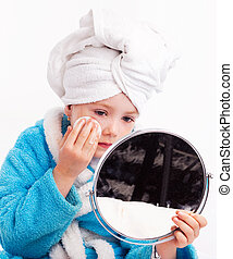 child applying makeup - beautiful five year old girl with a...