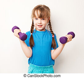 girl with dumbbells - beautiful five year old girl working...