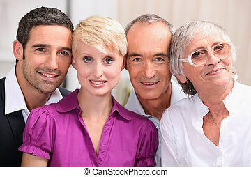 60 years old man and woman posing with 30 years old man and...