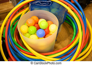 Kids toys - A bucket of plastic balls and some hula hoops