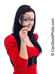 I see you! - Girl holding magnifying glass in front of her...