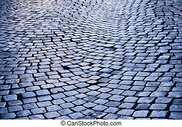 Wet Cobblestone - Rough texture of wet cobblestones, old...