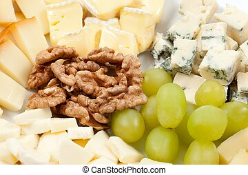 Cheese platter with nuts and grapes