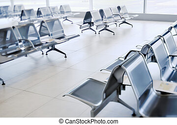 Waiting room - A row of metal chairs in the airport