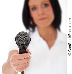 Female journalist asking for an interview. Selective focus...