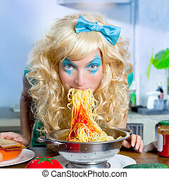Blonde funny on kitchen eating pasta like crazy - Blonde...