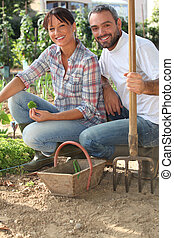 couple working in a kitchen garden