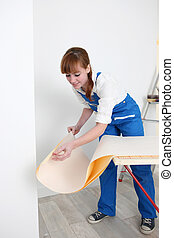 Woman preparing wallpaper
