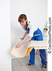 Woman preparing wallpaper