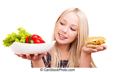 woman with vegetables and hamburger - thoughtful young woman...