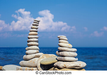 Gap - Two pile of pebbles in the balance on the seacoast