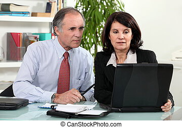 couple working together on laptop