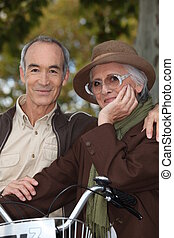 Elderly couple with bicycle