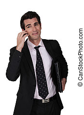 Smart businessman on phone