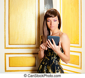 elegance fashion woman reading ebook tablet in a door