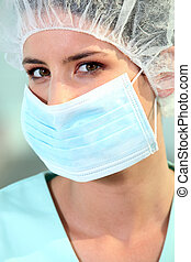 a surgeon with a mask