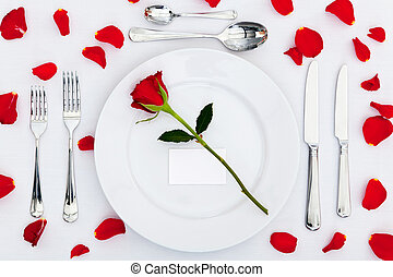 Place setting with red rose and petals - Photo of a table...