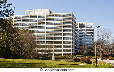 White Terraced Office Building in Winter - A white office...