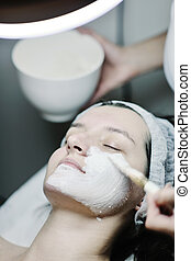 woman with facial mask in cosmetic studio - Young beautiful...