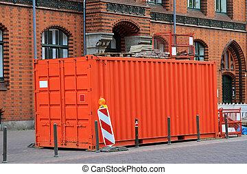 Cargo container - Orange cargo container at city street