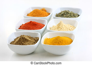 Spice bowls - Different Indian spices on bowls against white...