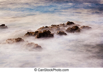 Ocean at sunrise, long exposure, blurred water