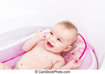Bathing Baby - Pretty girl is having a bath in her bathtub