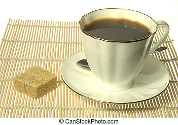 White Cup of coffee with sugar over yellow mat