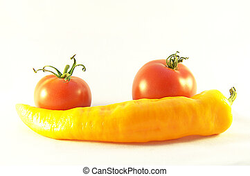 Red tomatos and yellow pepper
