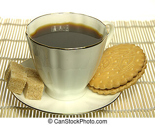 White Cup of coffee with cookie and sugar over yellow mat