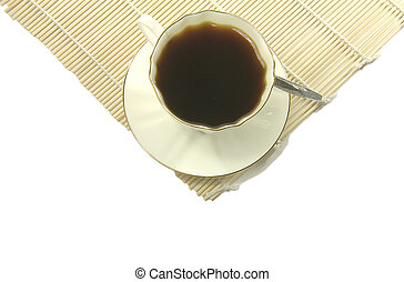 White Cup of coffee over yellow mat