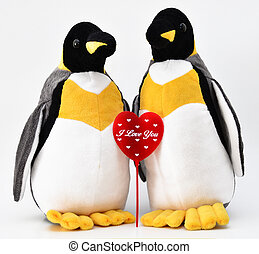 Love - Toy penguins shot with heart shape