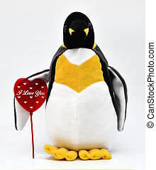 Love - Toy penguin shot with heart shape
