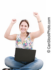 woman with laptop sitting on the floor and celebrating her...
