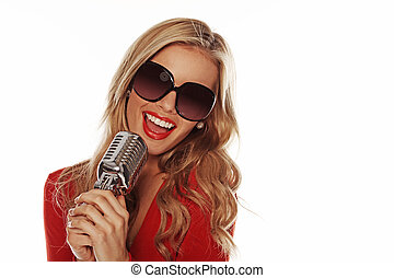 Beautiful Woman Singing Into Microphone