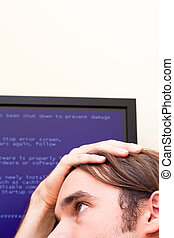 Computer error concept - Unhappy man looking at computer...