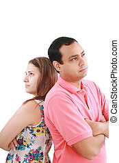 Young couple standing back to back having relationship...