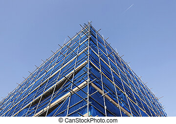 corner of blue scaffolding and blue sky with jet stream
