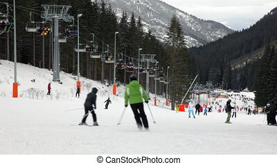 Jasna Ski Resort - Skiers and snowboarders going down the...