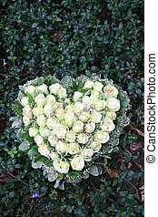 Heart shaped sympathy flower arrangement with white roses