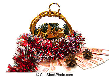 Cristmas basket, money and pinecones on white