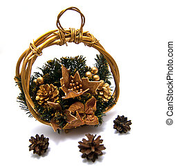 Three pinecones and Cristmas basket on white