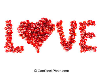 word of love from the seeds of a pomegranate isolated on...