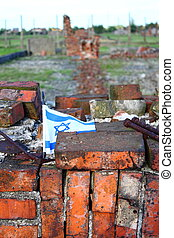 Holocaust - Israel flag over a demolished barrack in...