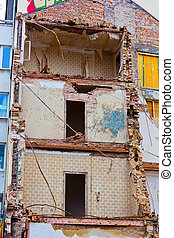 a residential building is demolished