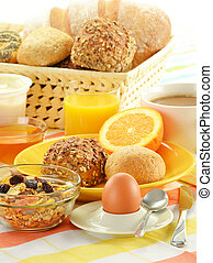 Breakfast including rolls, egg, cheese, coffee and orange...